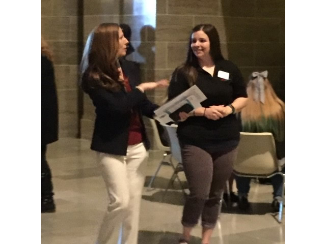 Emily Smith speaking with Representative Holly Rehder
